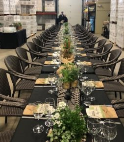 Long table set with place settings and flowers